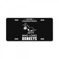 never underestimate who loves donkeys funny License Plate | Artistshot