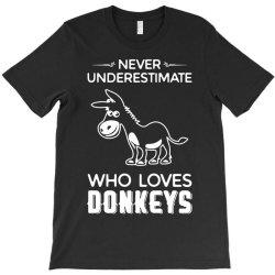 never underestimate who loves donkeys funny T-Shirt | Artistshot