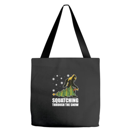 Christmas Bigfoot Squatching Through The Snow Tote Bags Designed By Blackstone